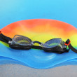 Swim cap and goggles on silver background — Stock Photo #40884321