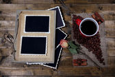 Composition with coffee cup and photo album, on wooden background — Foto Stock