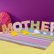 Mother- lettering of handmade paper letters on purple background — Stock Photo #40891835