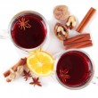 Mulled wine with lemon and spices isolated on white — Stock Photo