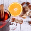 Stock Photo: Mulled wine with oranges and spices on wooden background