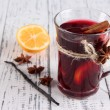 Stock Photo: Mulled wine with lemon and spices on wooden background