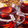 Stock Photo: Mulled wine with orange and spices on table close up
