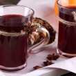 Stock Photo: Mulled wine with cookies on table close up
