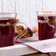 Stock Photo: Mulled wine with cookies on table on wooden background
