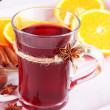Stock Photo: Mulled wine with oranges on table close up