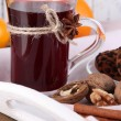 Stock Photo: Mulled wine with oranges and cookies on table on wooden background