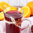 Stock Photo: Mulled wine with oranges and nuts on table on wooden background