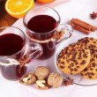 Mulled wine with oranges and cookies on table close up — Stock Photo #40898475