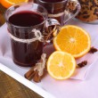 Mulled wine with oranges and cookies on table close up — Stock Photo #40898481