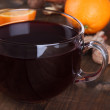 Stock Photo: Mulled wine with orange and spices on wooden background
