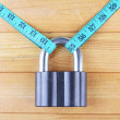 Stock Photo: Conceptual photo of unlocking secret of weight loss. On color wooden background