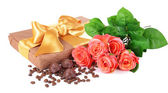 Delicious chocolates in box with flowers isolated on white — Stock Photo