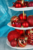 Christmas decorations on dessert stand, on color background — Stock Photo