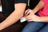 Pickpocket are stealing mobile phone from pocket, close up — Stock Photo