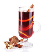 Mulled wine with nuts and spices isolated on white — Stock Photo
