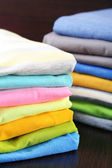 Stack of colorful clothes, on dark background — Foto Stock
