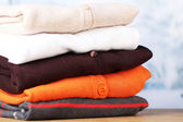 Stack of colorful clothes, on light background — Stock Photo