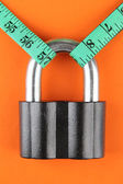 Conceptual photo of unlocking secret of weight loss. On color background — Stock Photo