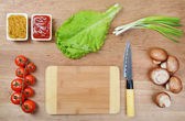 Different products on kitchen table close-up — Stock Photo