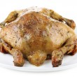 Stock Photo: Whole roasted chicken on plate, isolated on white