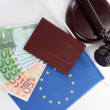 Gavel, money, passport and flag of Europe, isolated on white — Stock Photo