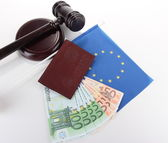 Gavel, money, passport and flag of Europe, isolated on white — Stockfoto