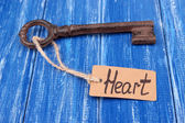 Key to heart, Conceptual photo. On color wooden background — Stock Photo