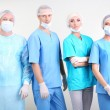 Stock Photo: Surgeons standing on grey background