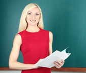 School teacher near blackboard close-up — Stock Photo