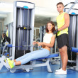 Girl and trainer in gym — Stock Photo