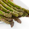 Delicious fresh asparagus on plate isolated on white — Stock Photo #40994131