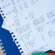 Math on copybook page closeup — Stock Photo #40994143