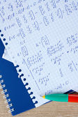 Math on copybook page closeup — Stock Photo