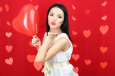Attractive young woman with balloon on Valentine Day — Stock Photo
