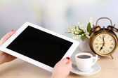 Tablet, cup of coffee and alarm clock, close up — Stock Photo