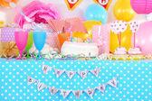 Festive table setting for birthday on celebratory decorations — Stock Photo