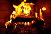 Fire in fireplace, close-up — Stock Photo