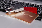 Credit cards and lock on keyboard close up — Stock Photo
