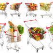 Trolleys with different products isolated on white — Stock Photo #41232313