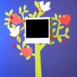 Holder in form of tree with instant photo cards on dark color background — Stock Photo