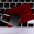 Stock Photo: Credit card and lock on keyboard close up