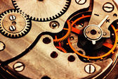 Clockwork details, pinions and wheels closeup — Stockfoto