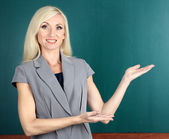 School teacher near blackboard close-up — Stockfoto