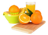 Citrus press and oranges isolated on white — Stock Photo