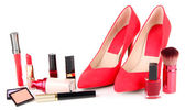 Beautiful red female shoes with cosmetics, isolated on white — Stock Photo