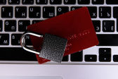 Credit card and lock on keyboard close up — Stock Photo