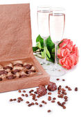 Delicious chocolates in box with flowers isolated on white — Stockfoto