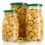 Three glass jars of marinated mushrooms isolated on white — Stock Photo #41339155