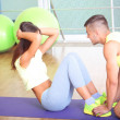 Girl and trainer engaged in fitness room — Stock Photo #41339535